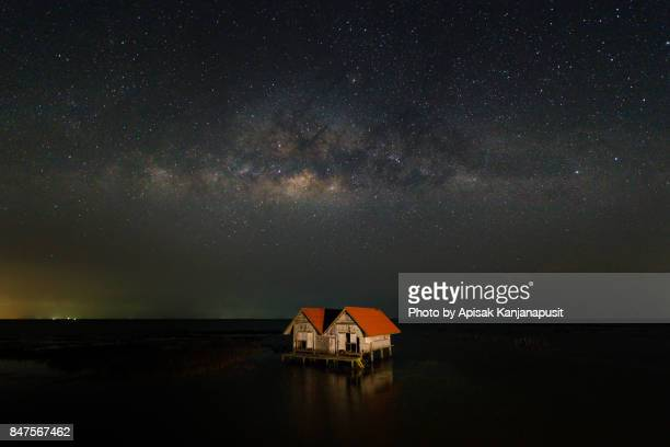 Abandoned House with Milky Way in Thale Noi lake at Phatthalung province, Thailand.