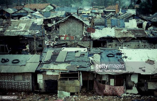 abandoned houses at slum area in city - slum stock pictures, royalty-free photos & images