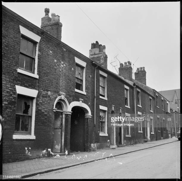 Abandoned houses in a terraced street StokeonTrent 19651968 This site is unidentified but is may be around Etruria or Hanley Artist Eileen Deste
