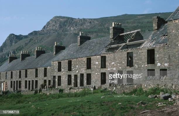Abandoned houses in a village by a derelict quarry Gwynedd Wales January 1983