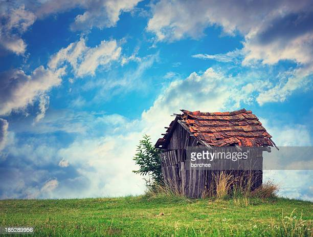 abandoned hut - hut stock pictures, royalty-free photos & images