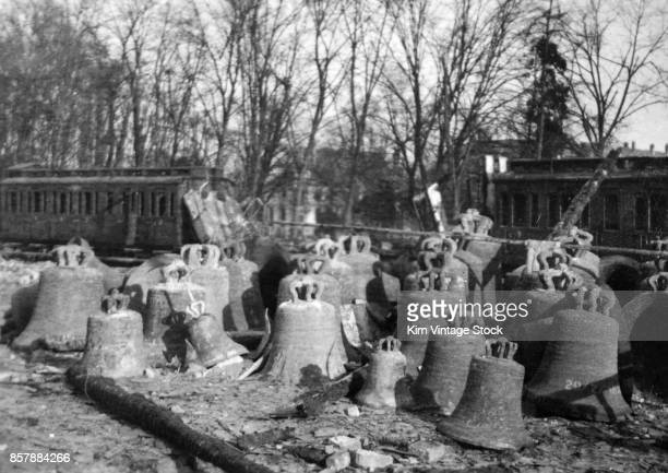 Abandoned iron church bells sit in a pile during the liberation of France The retreating Germans had stockpiled them for shipment back to Germany for...
