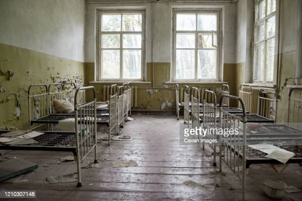 abandoned kindergarten in chernobyl, ukraine. kindergarten with toys and abandoned things - doll stock pictures, royalty-free photos & images