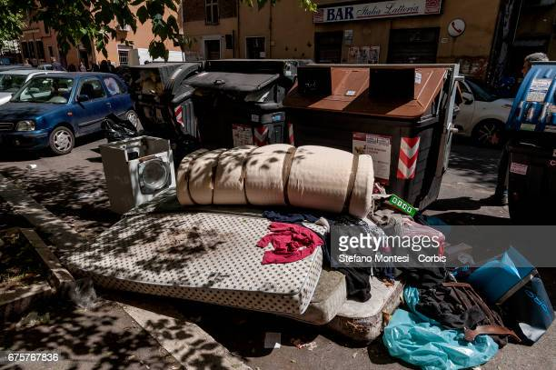 Abandoned mattresses and a washing machine near the waste bins on the street in Torpignattara neighborhood on May 1 2017 in Rome Italy Rome has...