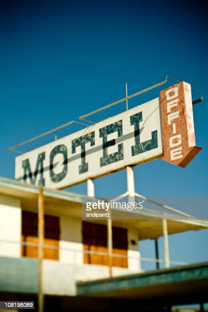 Abandoned Motel and Sign with Blue Sky Background