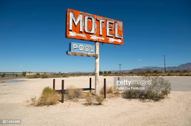 abandoned motel sign at yucca, mohave county, arizona state, usa - neon letters stock photos and pictures