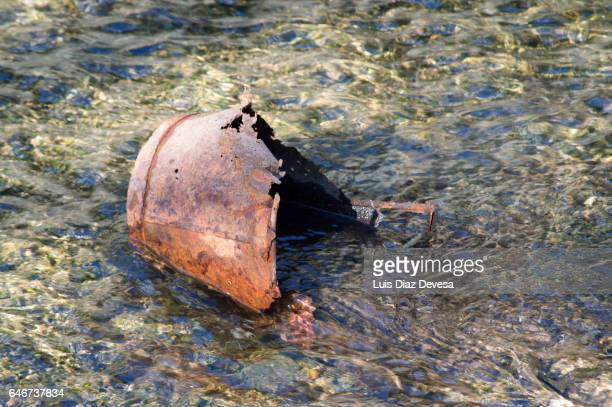 Abandoned old rusted bucket on River