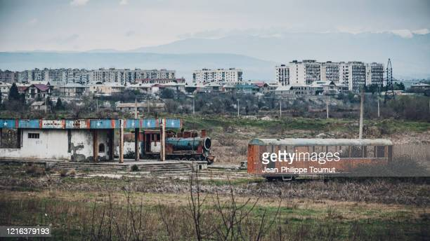 abandoned old-fashioned locomotive and train wagon - post-industrial feeling in near rustavi, georgia - former soviet union stock pictures, royalty-free photos & images