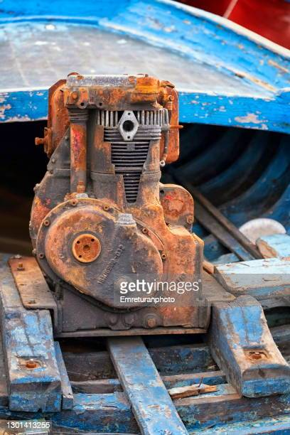 abandoned piston engine on a wooden boat. - emreturanphoto stock pictures, royalty-free photos & images