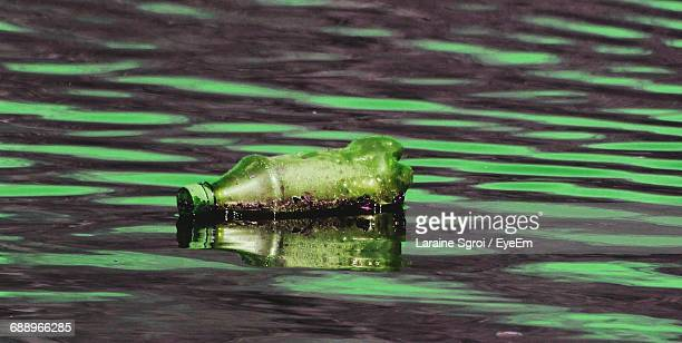 Abandoned Plastic Bottle On River