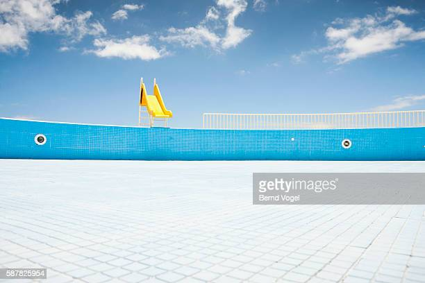 Abandoned pool with yellow slide