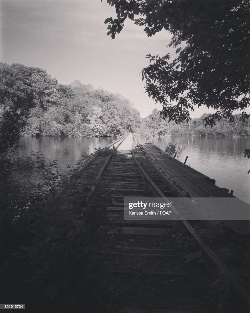 Abandoned railroad along with river : Stock Photo