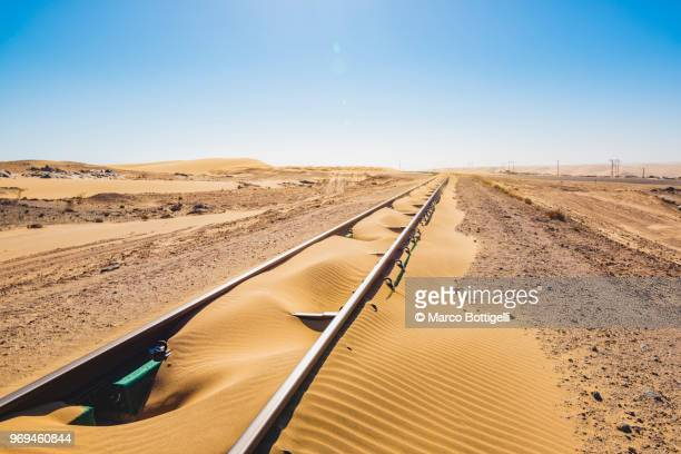 Abandoned railway track going into the sand dunes, Namibia