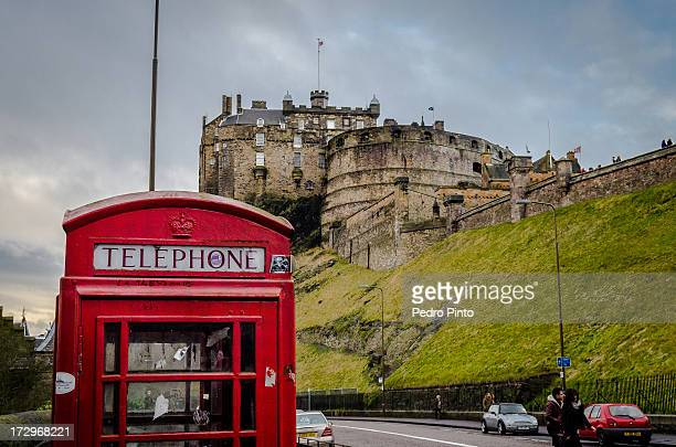 Abandoned red telephone box near Edinburgh Castle. The red telephone boxes are a token of the english presence in Scotland. Maybe not always...