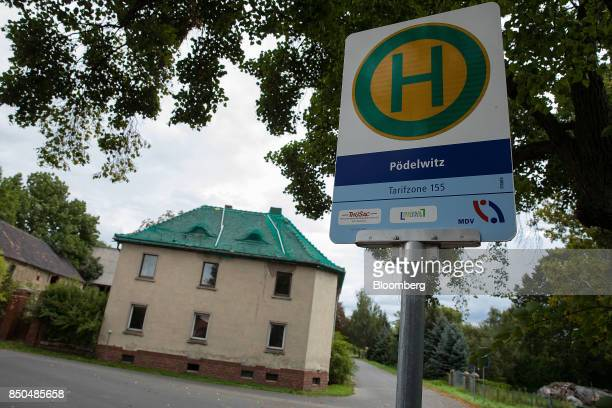 Abandoned residential property sits beyond a bus stop in the village of Poedelwitz Germany on Wednesday Sept 6 2017 By 2030 the eastern German town...