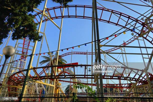 abandoned roller coaster in a lunapark on a sunny autumn day,izmir. - emreturanphoto stock pictures, royalty-free photos & images