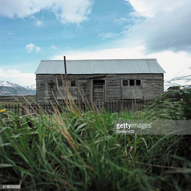 Abandoned Rural Property Seen Through Long Grass