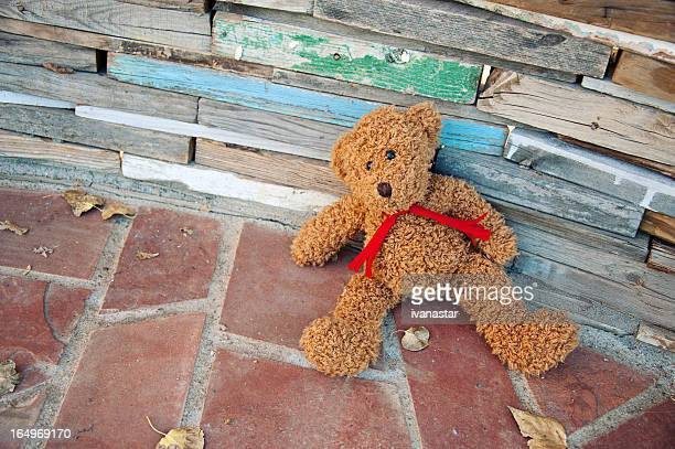 abandoned, sad, old teddy bear - child abuse stock pictures, royalty-free photos & images