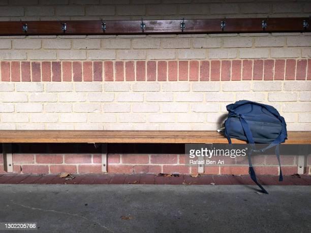 abandoned school bag on a bench - rafael ben ari fotografías e imágenes de stock