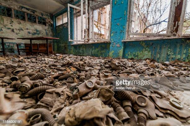 abandoned school in the city of pripyat, ukraine - chernobyl stockfoto's en -beelden