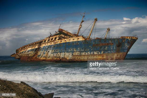 Abandoned Ship In Sea Against Sky