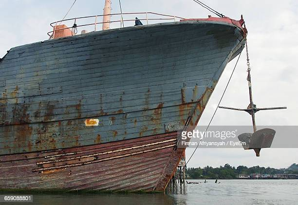 Abandoned Ship Moored In Sea