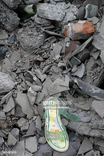 Abandoned shoe amidst the rubble of a former home in Hanwang, near epicenter of China, Wenchuan May 12th, 2008 Earthquake that registered 8.0 on...