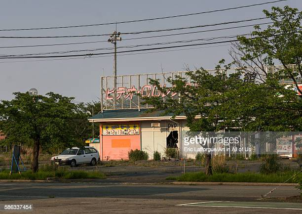 Abandoned shop in the difficulttoreturn zone after the daiichi nuclear power plant irradiation fukushima prefecture tomioka Japan on May 22 2016 in...