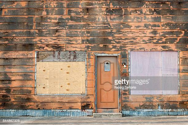 abandoned shop - boarded up stock photos and pictures