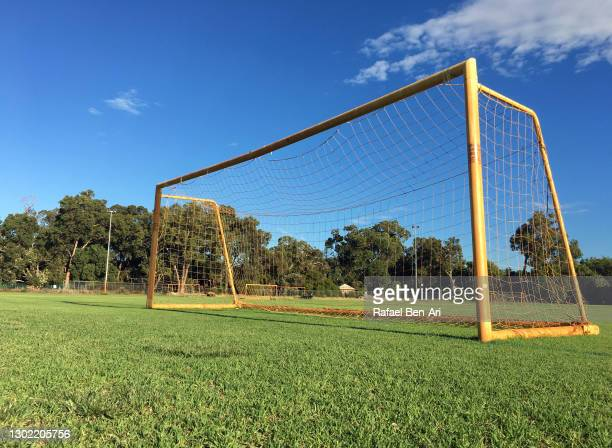 abandoned soccer goal in a public playground - rafael ben ari stock pictures, royalty-free photos & images
