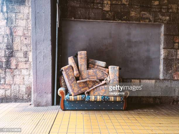 abandoned sofa on the street - stack stock pictures, royalty-free photos & images
