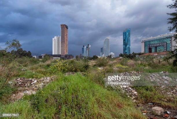 abandoned space and skyscrapers at the background,izmir. - emreturanphoto stock pictures, royalty-free photos & images