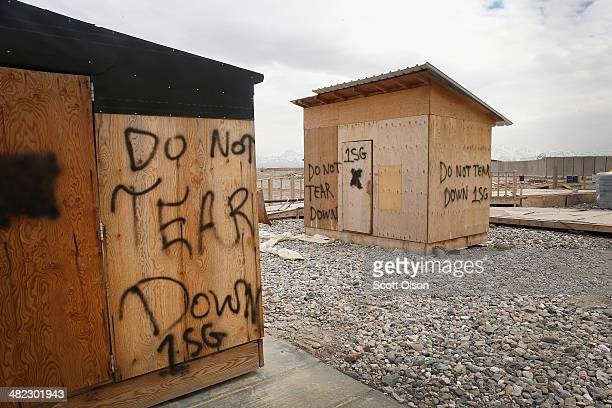 Abandoned storage builings sit in an area on Forward Operating Base Shank that due to a shrinking population on the FOB is no longer used on April 3...