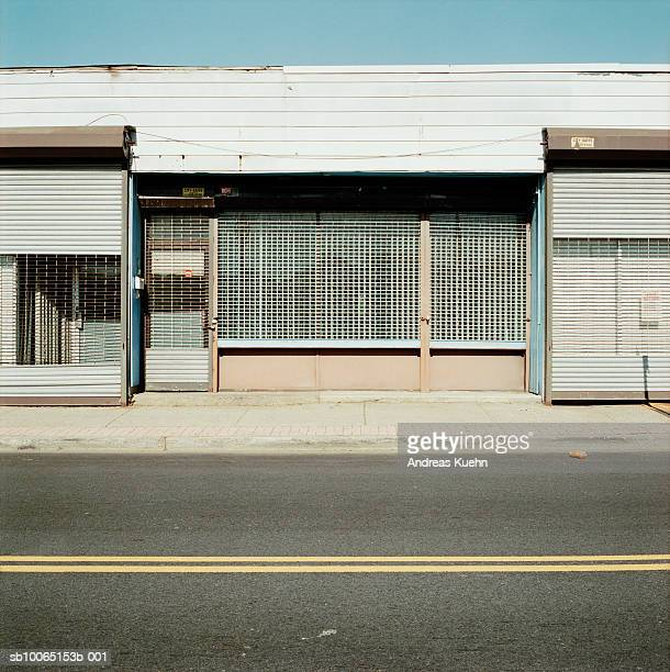 Abandoned store fronts boarded up