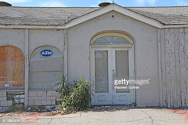 Abandoned store in Downey California Windows and doors are both papered and boarded