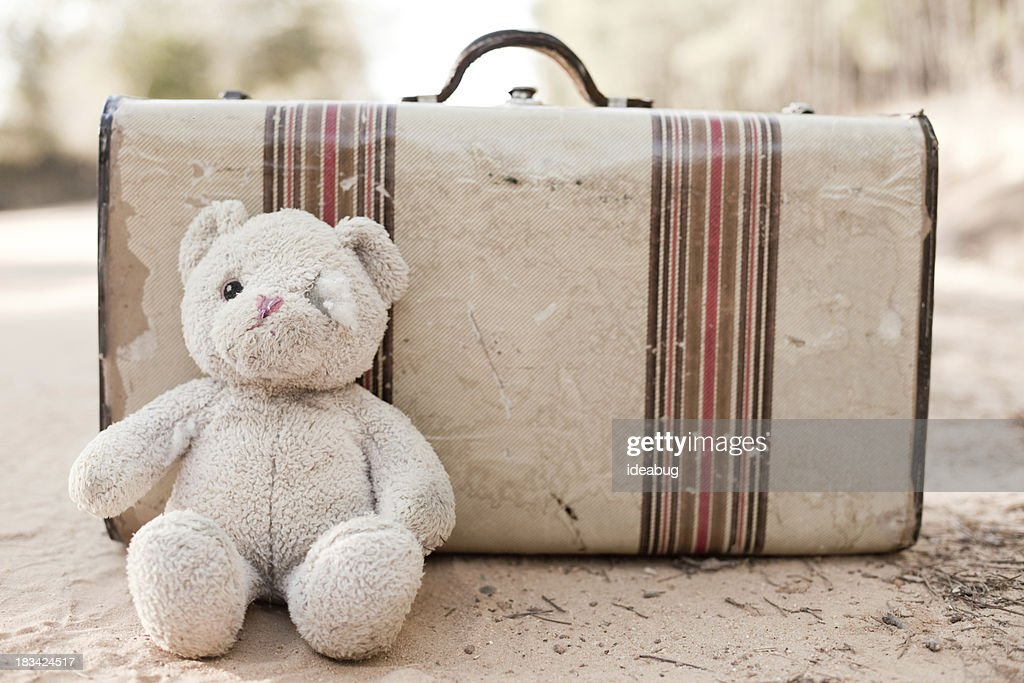 Abandoned Suitcase with Teddy Bear on Dirt Road : Stock Photo