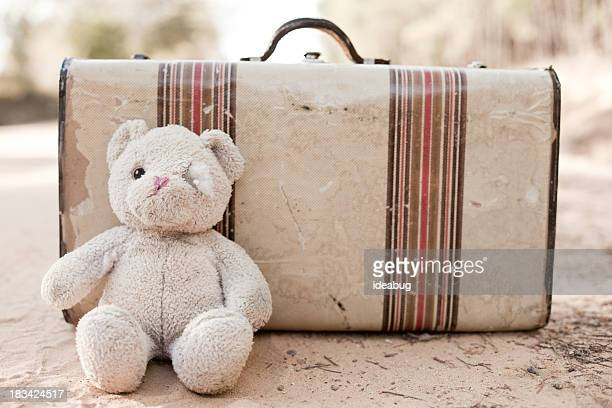 abandoned suitcase with teddy bear on dirt road - bear tracks stock photos and pictures