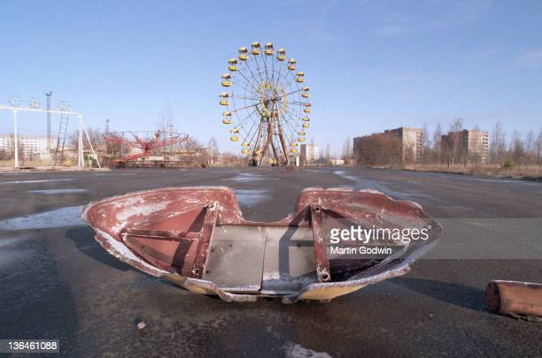 Abandoned swing boat and Ferris Wheel in the Pripyat Central Park evacuated town two kilometres from the Chernobyl power station November 1995