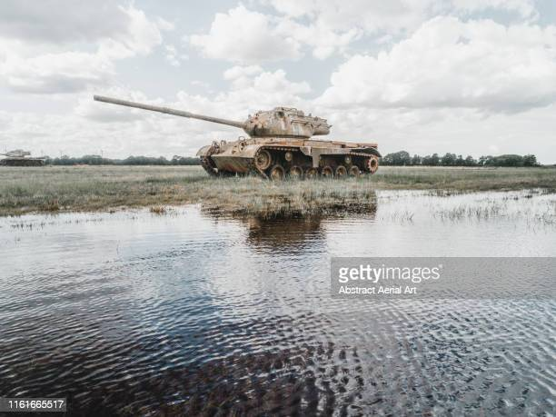 abandoned tank in a german field - armored tank stock pictures, royalty-free photos & images