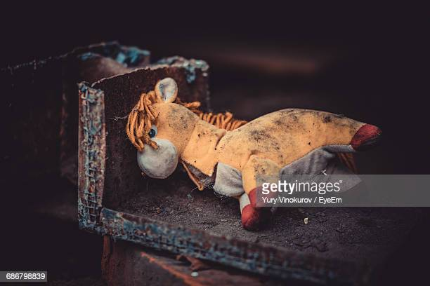 abandoned toy on metallic shelf - abandoned stock photos and pictures