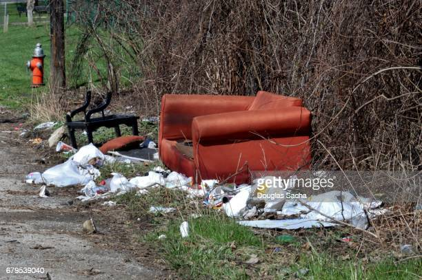 abandoned trash on a rural street corner - ghetto trash stock pictures, royalty-free photos & images