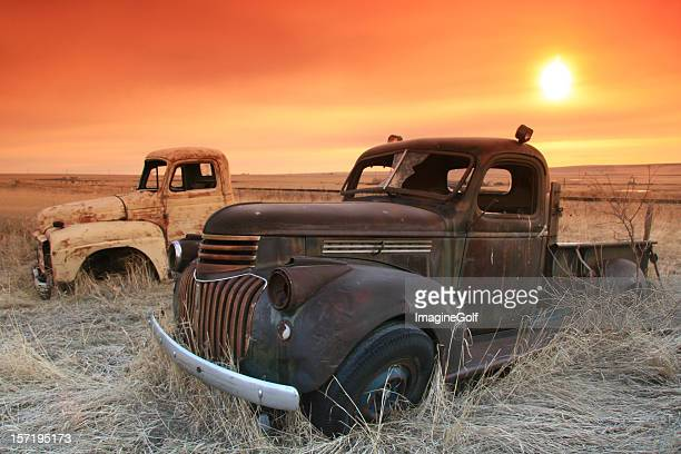 Abandoned Trucks on the Prairie With Sunrise