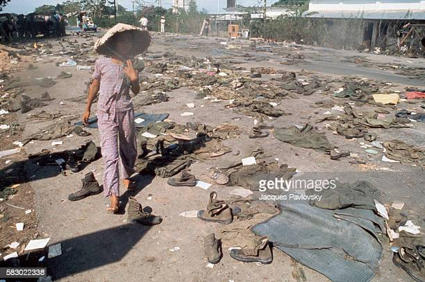 Abandoned uniforms of South Vietnamese soldiers lie on the road after the invasion of North Communist troops which led to the Fall of Saigon