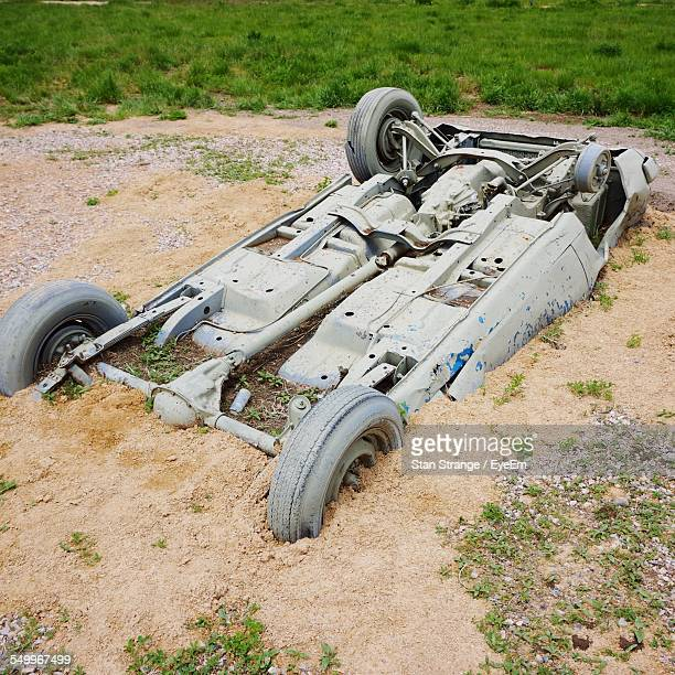 Abandoned Upside Down Car Half Buried In Sand