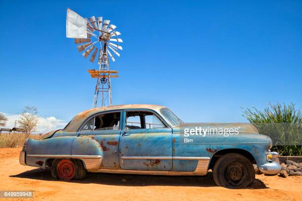 abandoned vintage car in the desert - vintage car stock pictures, royalty-free photos & images