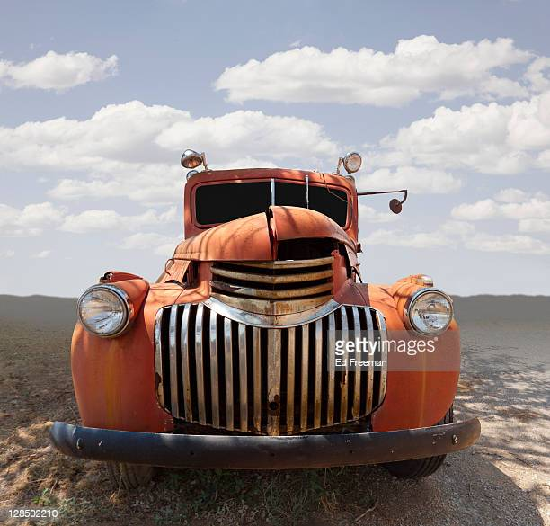 abandoned vintage truck in field - rusty old car stock pictures, royalty-free photos & images