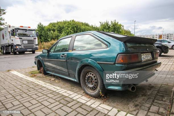 Abandoned Volkswagen Scirocco GT II car wreckage on the public parking lot is seen in Gdansk, Poland, on 27 August 2020 The Gdansk City Guard is...