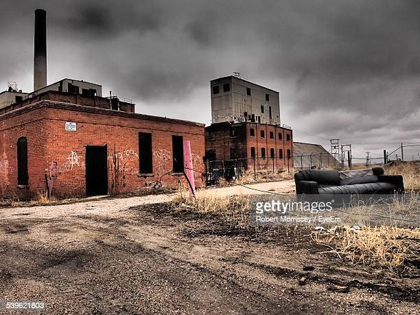 abandoned warehouse on cloudy day - business closing stock photos and pictures