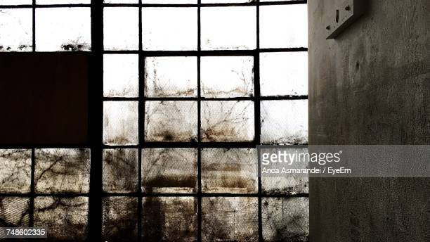 Abandoned Window By Wall