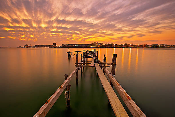 Abandoned wooden pier at dusk